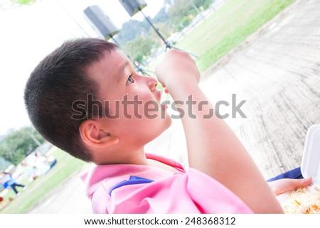 Child eating food - stock photo