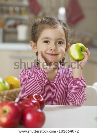 Child eating healthy breakfast - stock photo