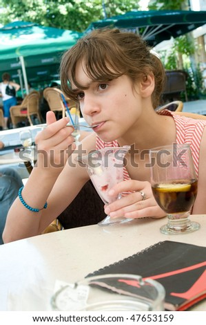 Child eating ice cream on the restaurant - stock photo