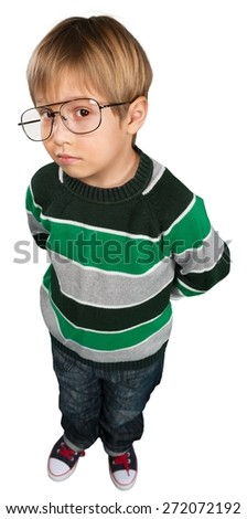 Child. Education concept image. Clever boy standing on stack of books at the green planet - stock photo