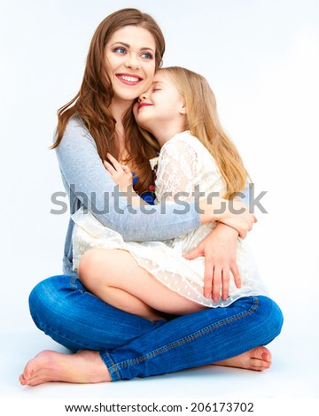 Child embrace her mother. Isolated portrait. - stock photo