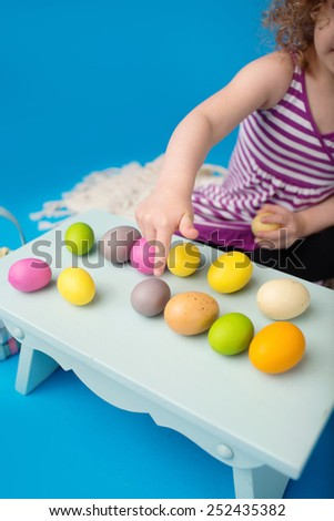 Child engaged in an Easter Activity  - stock photo