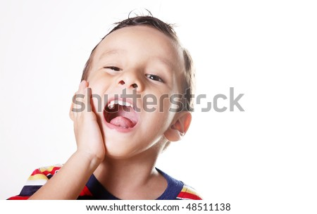 Child expressing pain and screaming with his hand in his face
