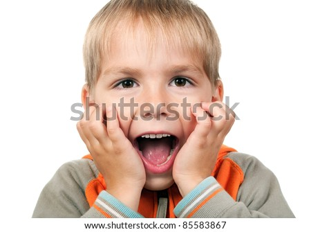 Child expressing surprise with his hands in his face isolated on white background - stock photo
