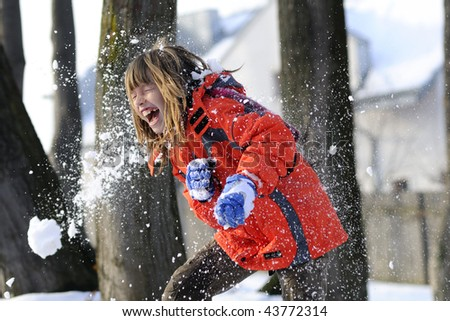 child fighting with snowballs - stock photo