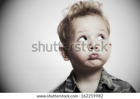Child. funny little boy. 4 years old. military shirt - stock photo