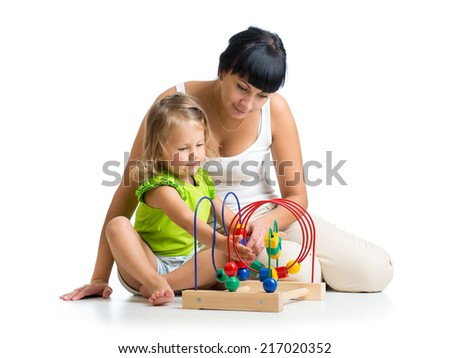 child girl and mother play with color educational toy - stock photo