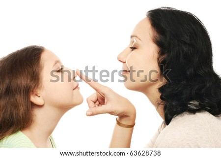 Child girl and Mother profiles. Playful woman with nose Daughter playing smiling isolated on white.