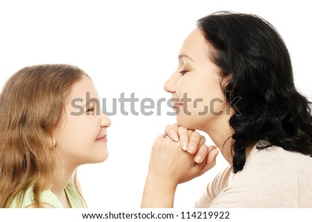Child girl and mother smiling Woman with daughter profile isolated on white - stock photo