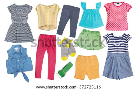 Child girl clothes colorful isolated on white.Kid's female apparel cotton.Set of summer bright fancy clothing. - stock photo
