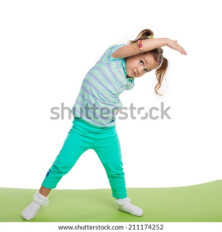 Child girl doing fitness exercises