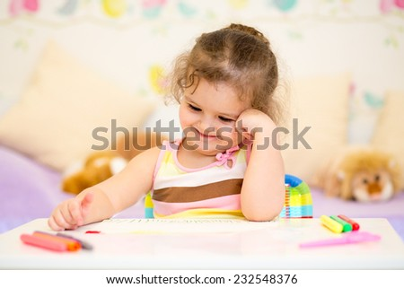 child girl drawing in nursery at home - stock photo