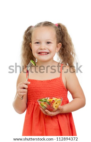 child girl eating with healthy food vegetables - stock photo