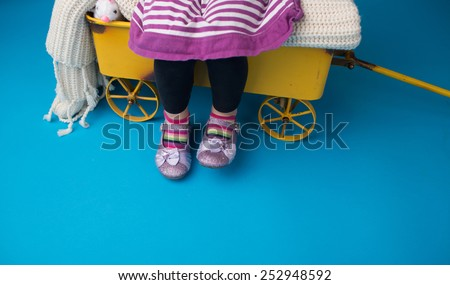 Child, girl fashion: striped socks and dress and girly sparkly shoes - stock photo