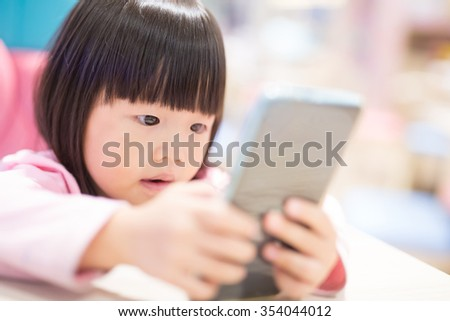 child girl happy look smart phone. asian child