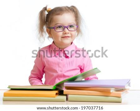 child girl in glasses reading book  - stock photo