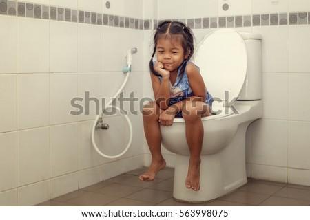 Child Girl Toilet Stock Photo 563998075 - Shutterstock