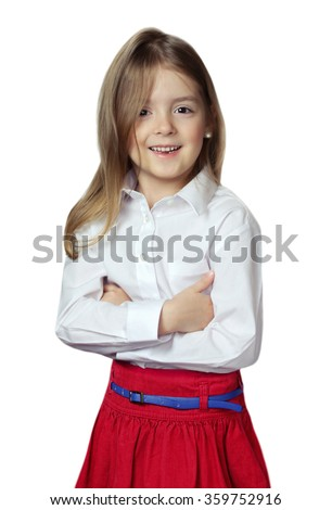 Child girl in white shirt red skirt isolated on white. Toddler kid smiling happy face.Studio portrait. - stock photo