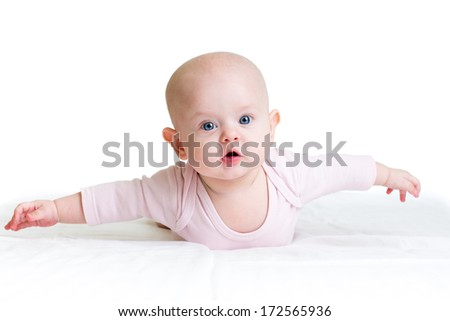 child girl lying on her tummy with outstretched arms