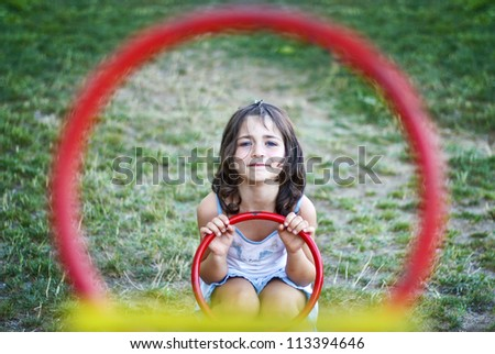 Child girl playing on a swing scales. Like targeted - stock photo