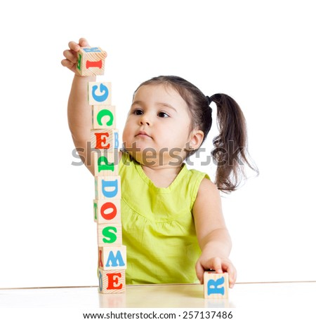 child girl playing with block toys on white background - stock photo