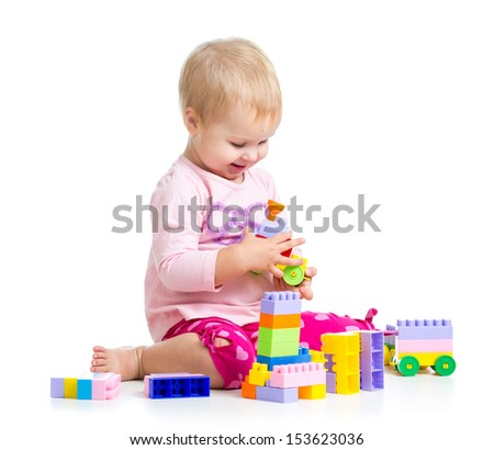 child girl playing with construction set over white background - stock photo