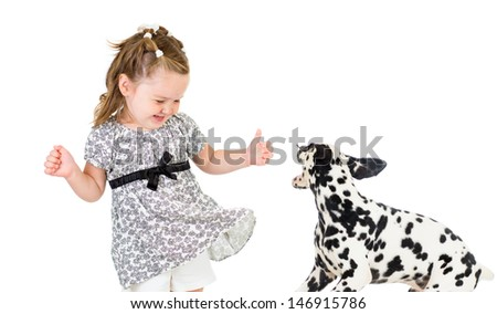 child girl playing with dog - stock photo