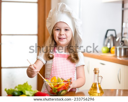 child girl preparing healthy food at kitchen - stock photo