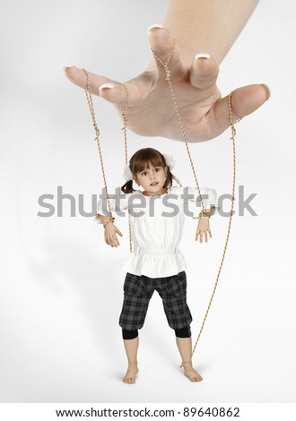 child girl - puppet , dependence concept - stock photo