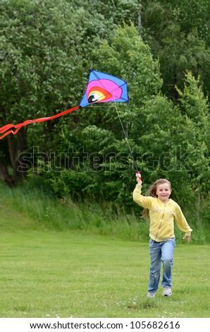 Child girl runs with kite - stock photo