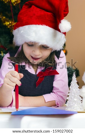 Child girl wrote a letter to Santa Claus - stock photo