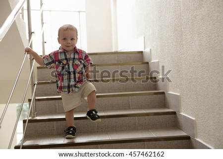 Child going upstairs in hotel in morning - stock photo