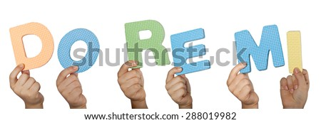 Child hand holding Do Re Me, the first three musical notes used in solfege isolated on white background