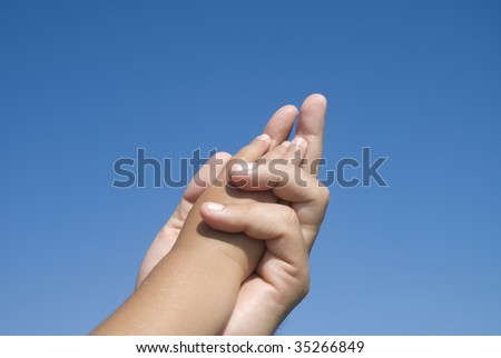 Child hand in father 's hand - stock photo