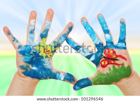 Child Hand Painted on spring background, See my portfolio for more - stock photo