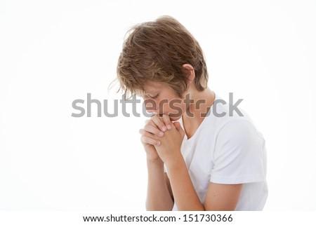 child hands clasped in prayer praying - stock photo