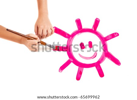 Child hands painting a happy sun, isolated on white - stock photo