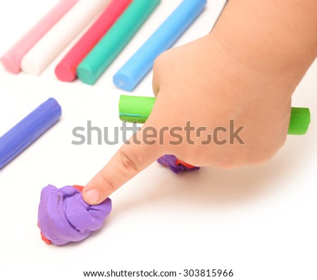 Child hands playing with colorful clay - stock photo