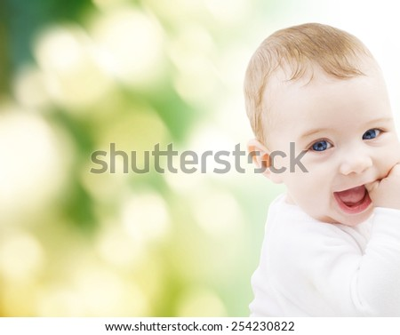 child, happiness and people concept - adorable baby boy - stock photo