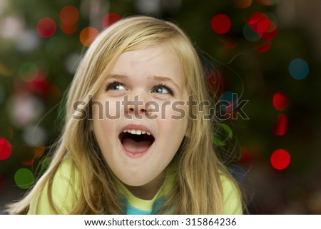 Child happy during christmas time over her presents - stock photo