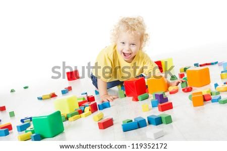 Child happy playing blocks over white - stock photo