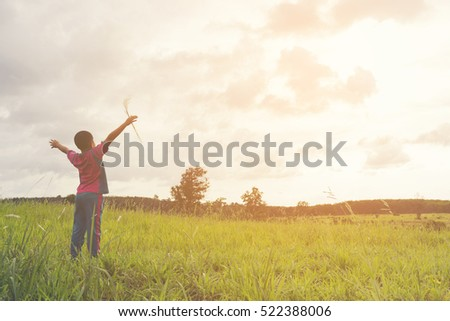 Child happy with mountain view,Or boy happy for travel and relax with mountain and sunshine view.