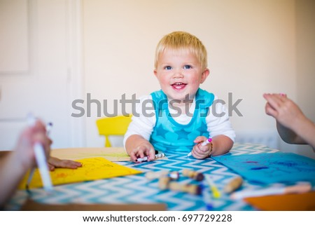 Child having fun drawing and painting