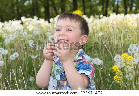 child having fun in a field during summer