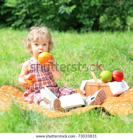 Child having picnic in summer park - stock photo