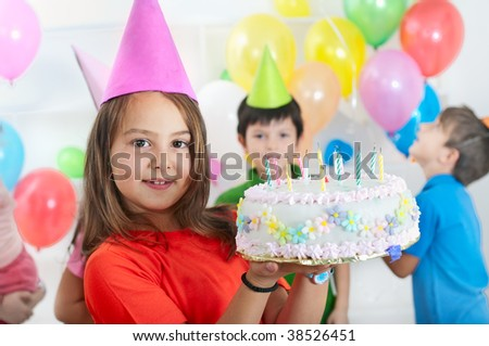 child hold a birthday cake