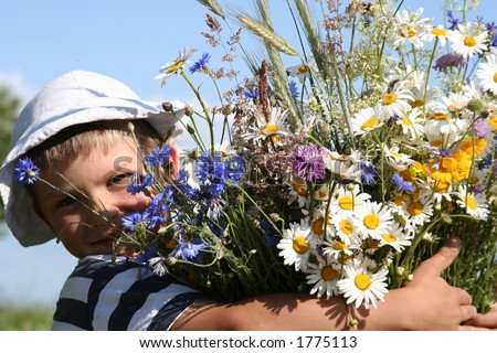 Child holding a bouquet of flowers