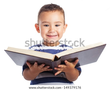 Child holding a open book on white background