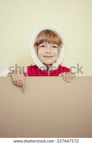 Child holding Christmas card. Xmas holiday concept - stock photo