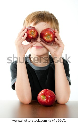 Child Holding Two Red Apples - stock photo